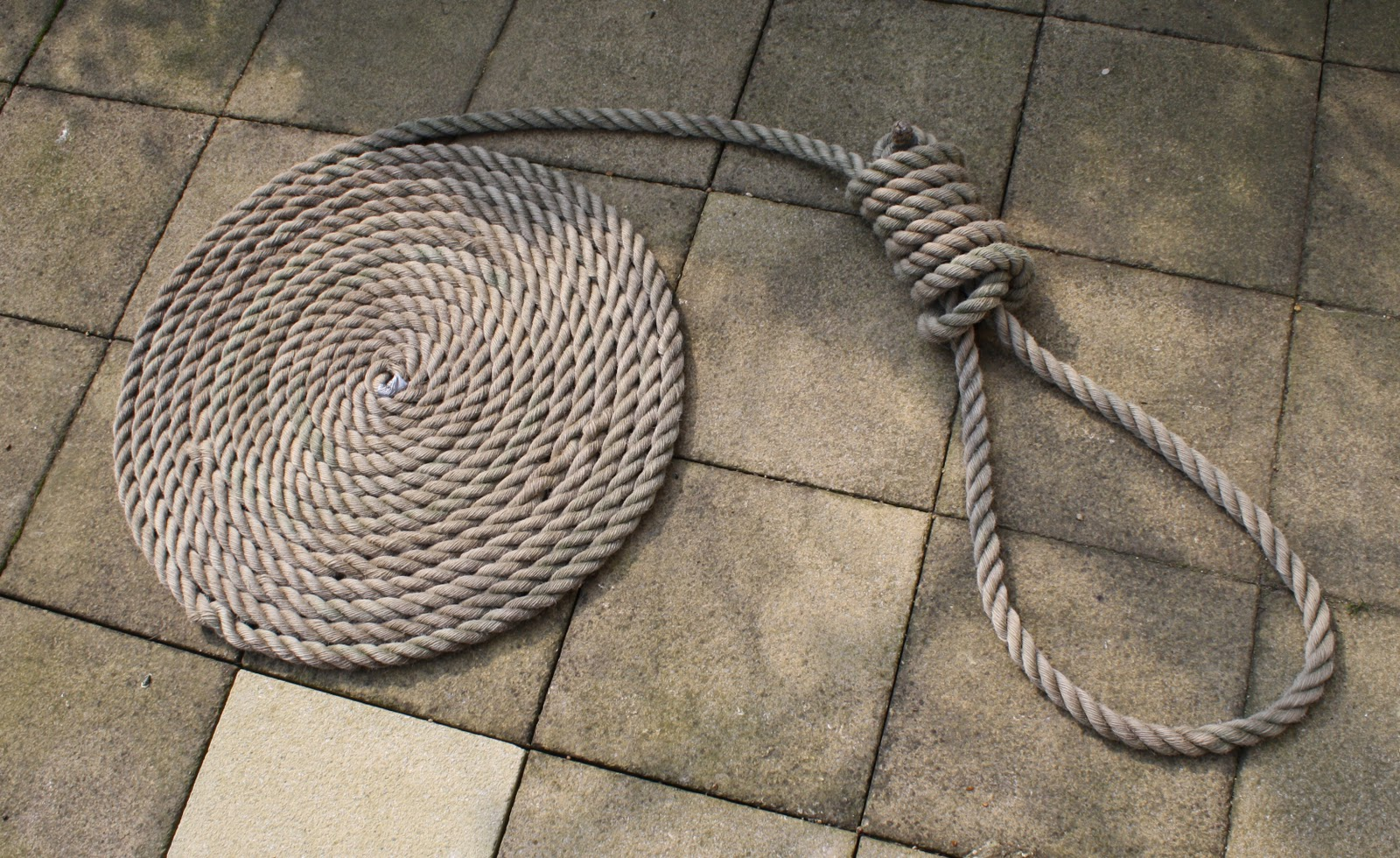 Coiled up rope with hangmans noose